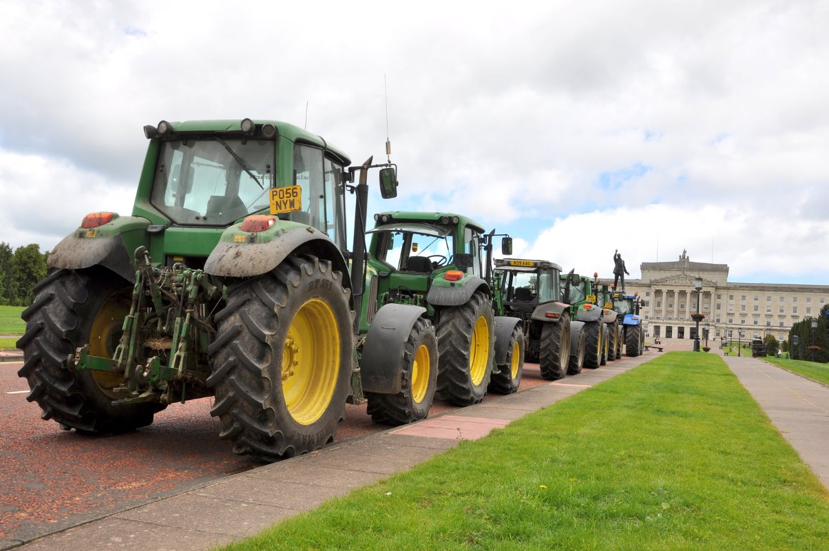 Tractors line the avenue to Northern Ireland's Parliament Buildings in Belfast at the dairy protest.