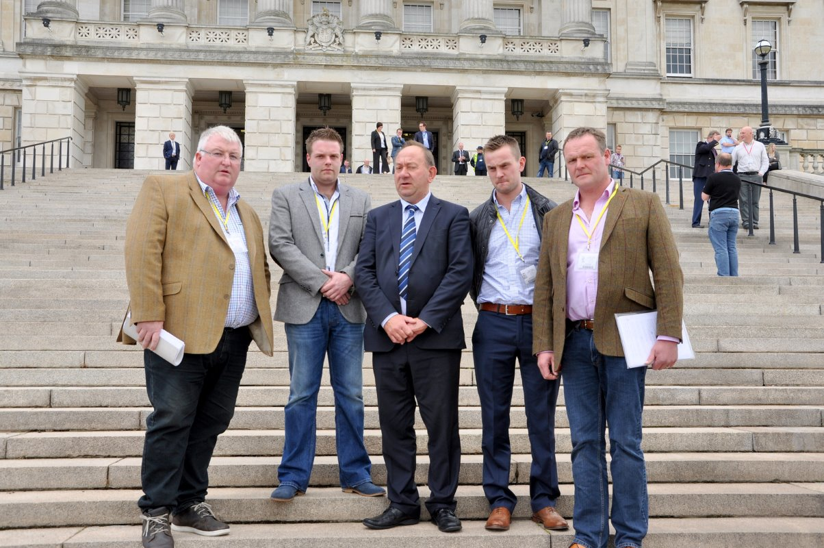 Banbridge area dairy farmers Charlie Weir, Johnny Matthews, James Stewart and Kyle Savage are joined by William Irwin, centre, chair of the Agriculture and Rural Development committee at Stormont.