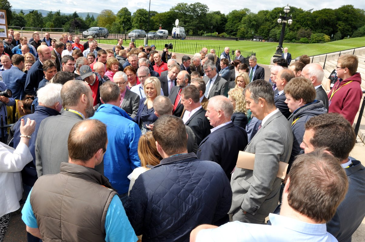 DARD Minister Michelle O'Neill is surrounded by angry dairy farmers at Stormont protesting against the poor milk prices.