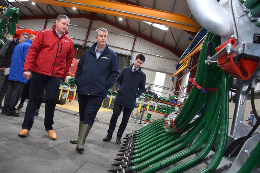 SlurryKat CEO Garth Cairns, left, with Daera Northern Ireland Agriculture Minister Edwin Poots, centre, and DUP MLA Jonathan Buckley. Photo: Chris McCullough