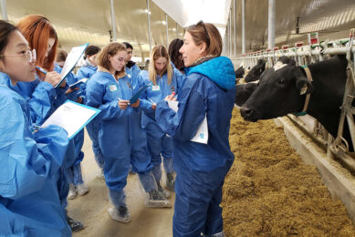 Visitors from a post-secondary institution in Canada wear protective clothing and shoe covers while touring a dairy farm to learn about proAction. Photo: Dairy Farmers of Canada